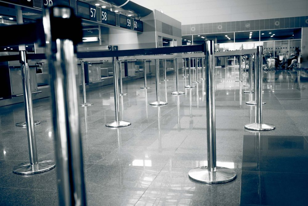 chrome stainless steel retractable belt stanchions in the lobby of an airport